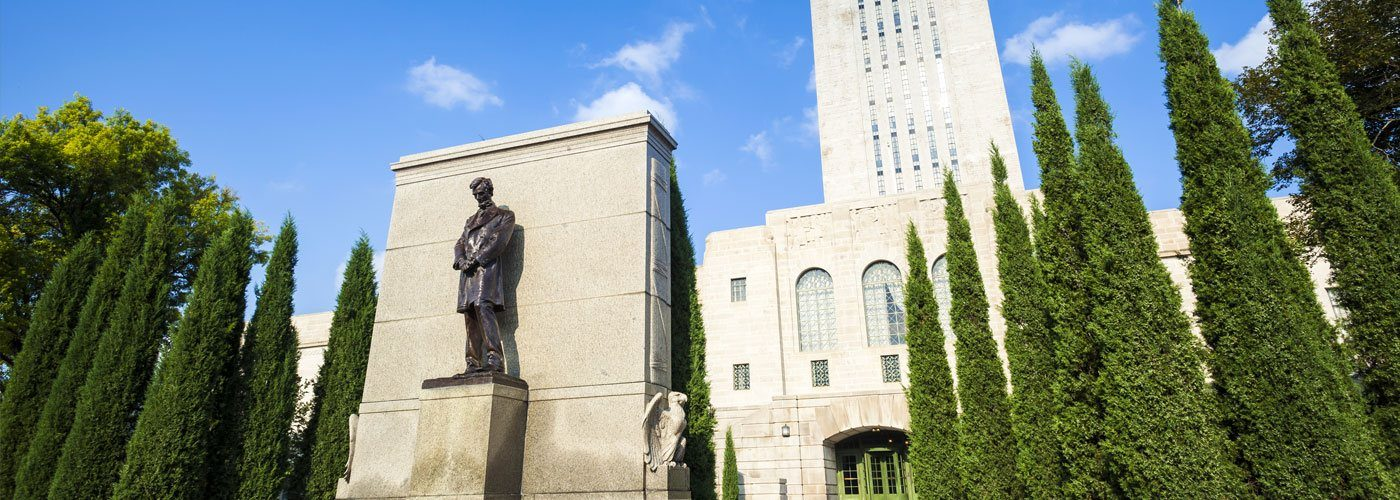 The Nebraska State Capitol Building with the statue of Abraham Lincoln.